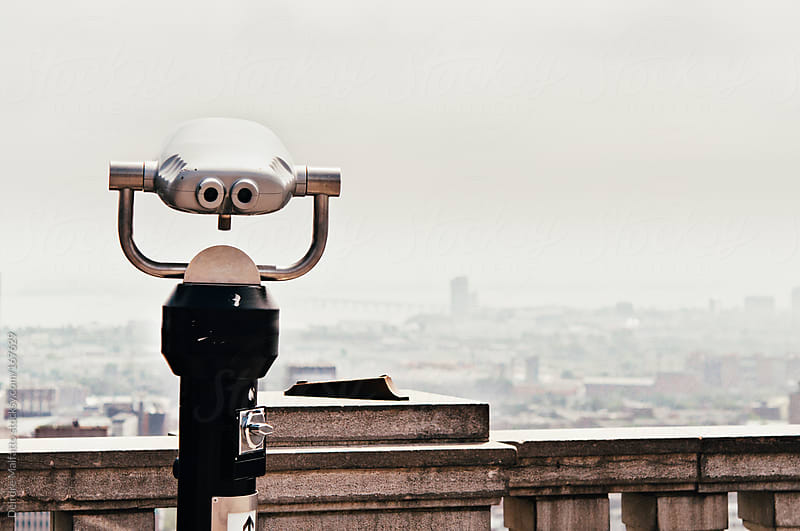 view finder looking out over Montreal by Deirdre Malfatto for Stocksy United