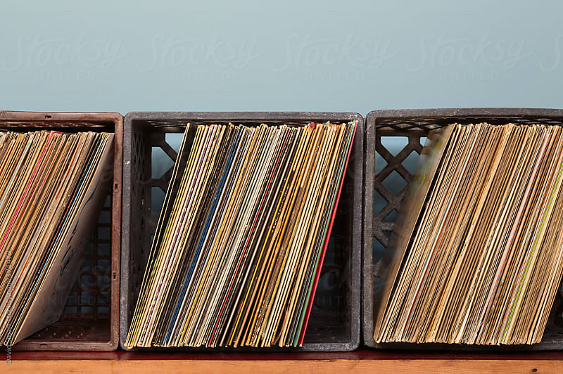 Vinyl record albums in milk crates by David Smart for Stocksy United