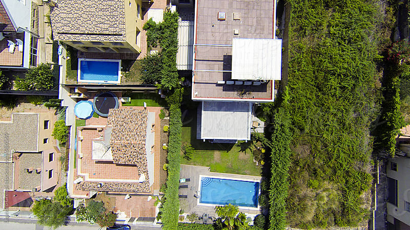 Aerial view of a houses's gardens with a swimming pool by Leandro Crespi for Stocksy United