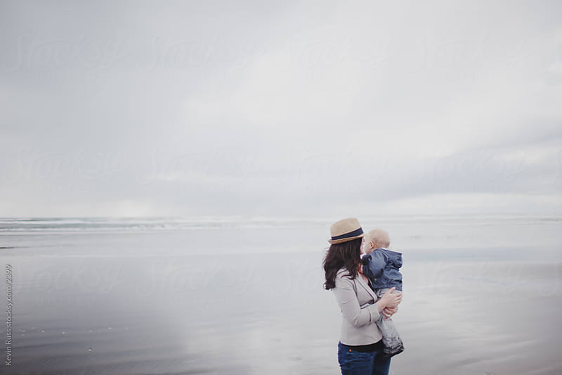 Mother Holding Son at Beach by Kevin Russ for Stocksy United