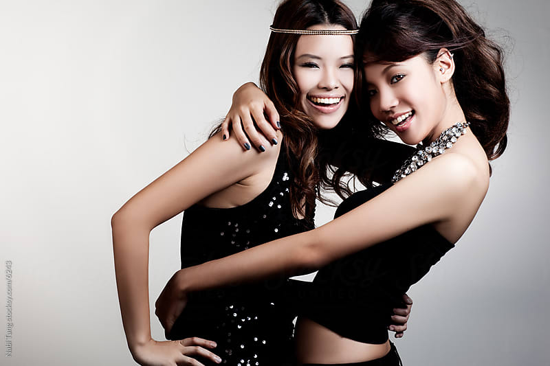 Asian girls having fun dressing up for the party by Nabi Tang for Stocksy United