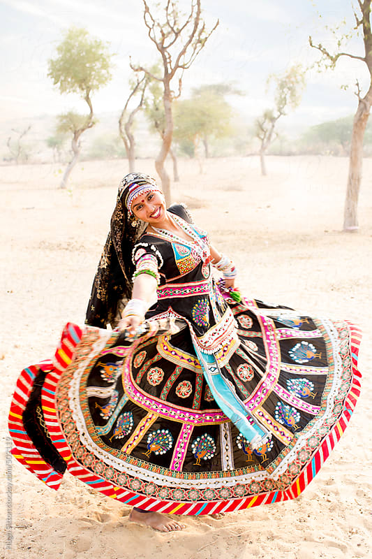 Traditional dancers performing in desert. Rajasthan. India. by Hugh Sitton for Stocksy United