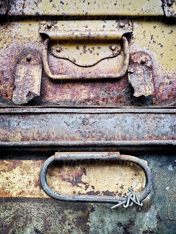 Rusty metal cases by James Ross for Stocksy United