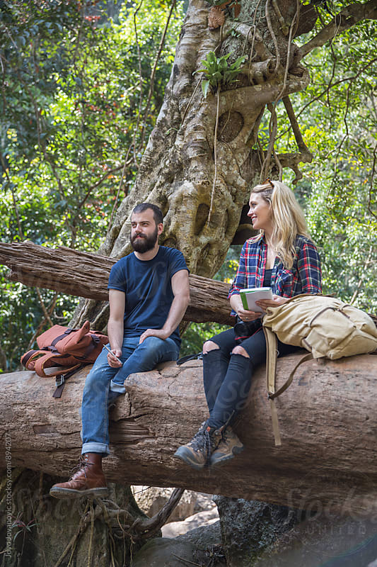 Couple hanging out together in nature by Jovo Jovanovic for Stocksy United