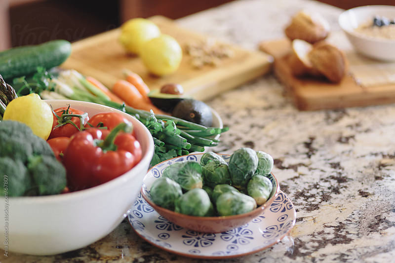 Vegetables on the counter in the kitchen by Ania Boniecka for Stocksy United