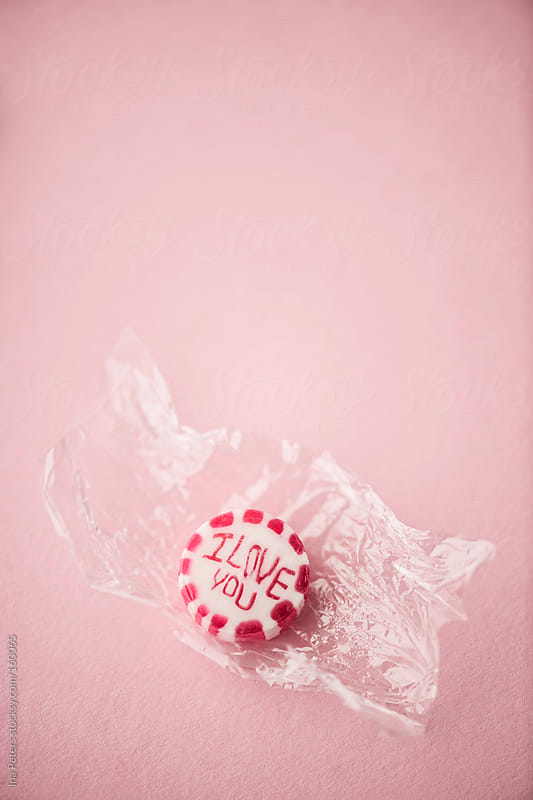 Food: I LOVE YOU Drop Unwrapped on Pink Background by Ina Peters for Stocksy United