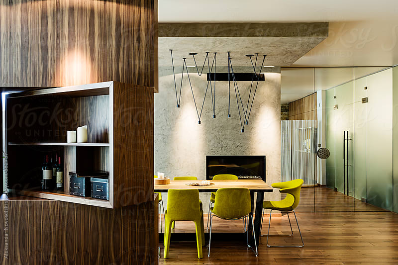 Dining room in contemporary interior by Aleksandar Novoselski for Stocksy United