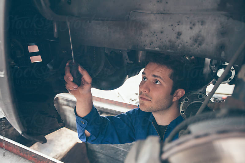 Mechanic Repairing a Car by Lumina for Stocksy United