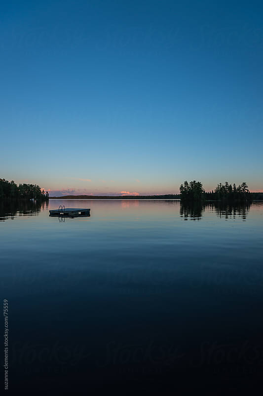 Clear Skies and a Peaceful Nothern Lake at Dusk by suzanne clements for Stocksy United