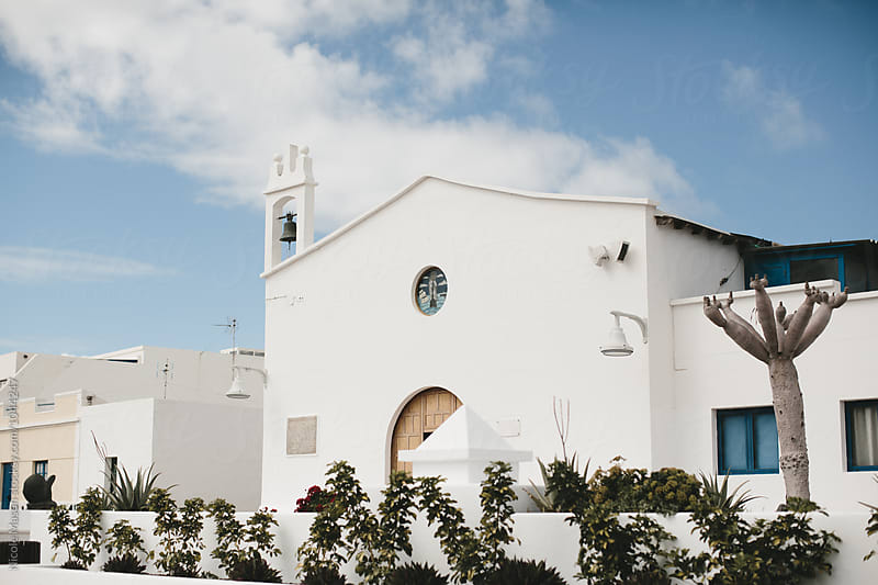 white church on desert island in spain by Nicole Mason for Stocksy United