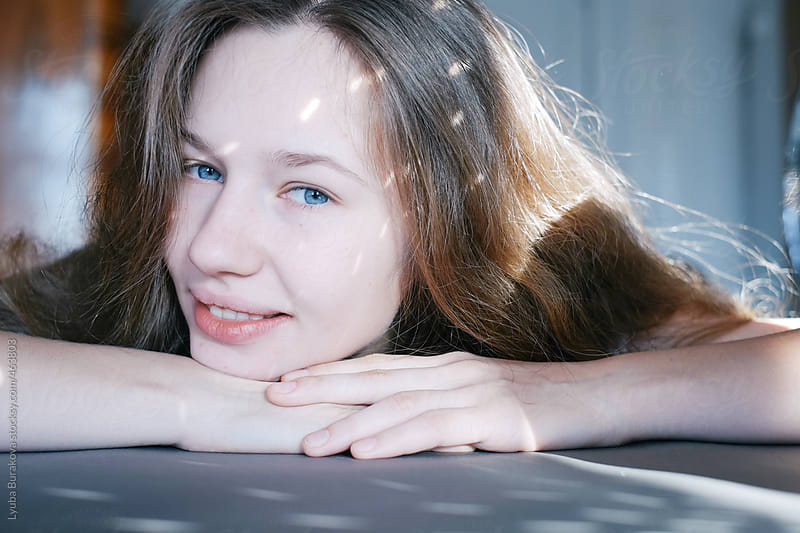 Portrait o the young girl with sunspots by Lyuba Burakova for Stocksy United