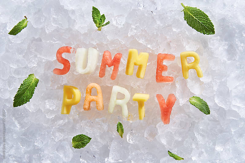 Summer party fruit words on ice by Martí Sans for Stocksy United