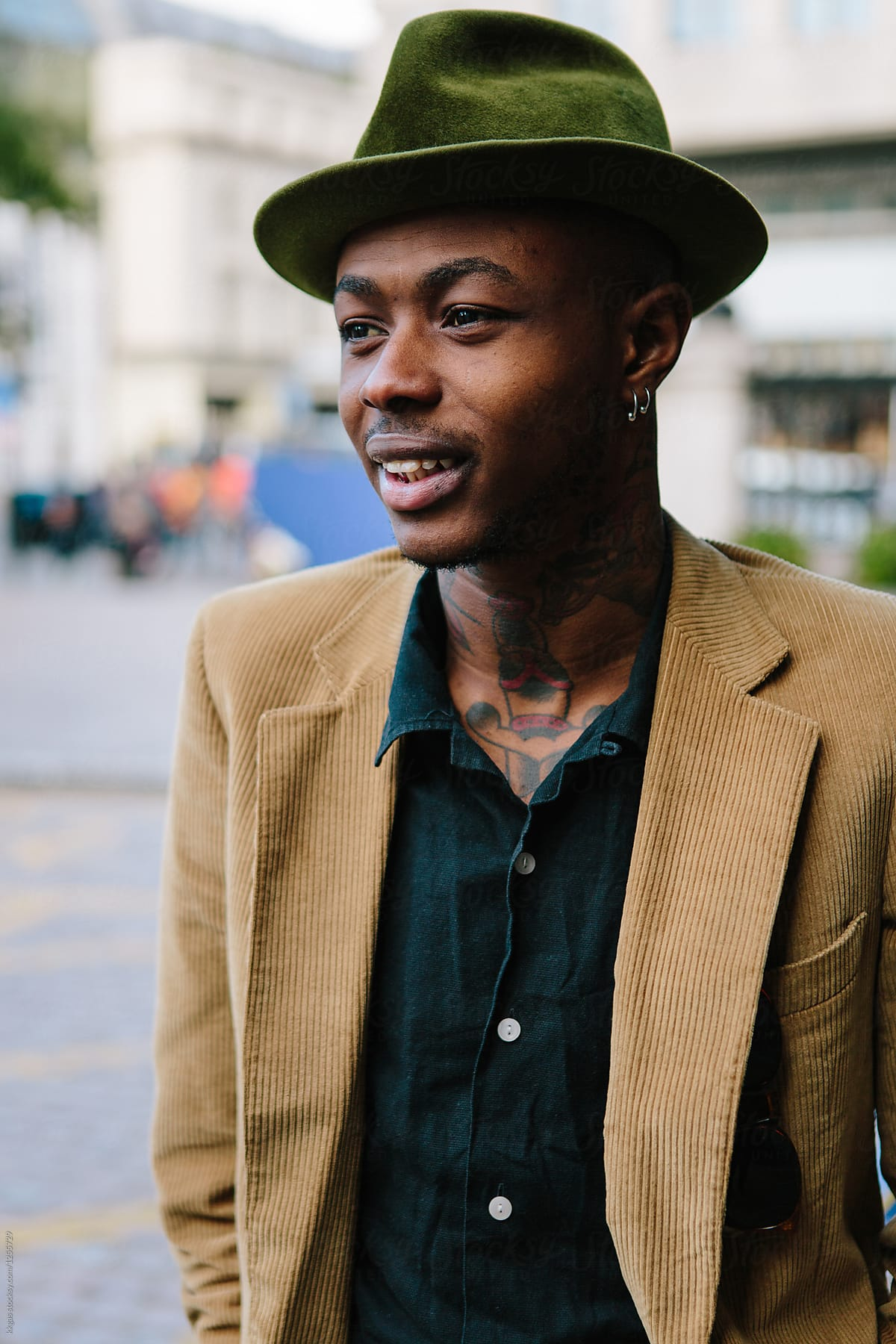 da39f93e35872 Stylish Young Black Man With Tattoos And Hat