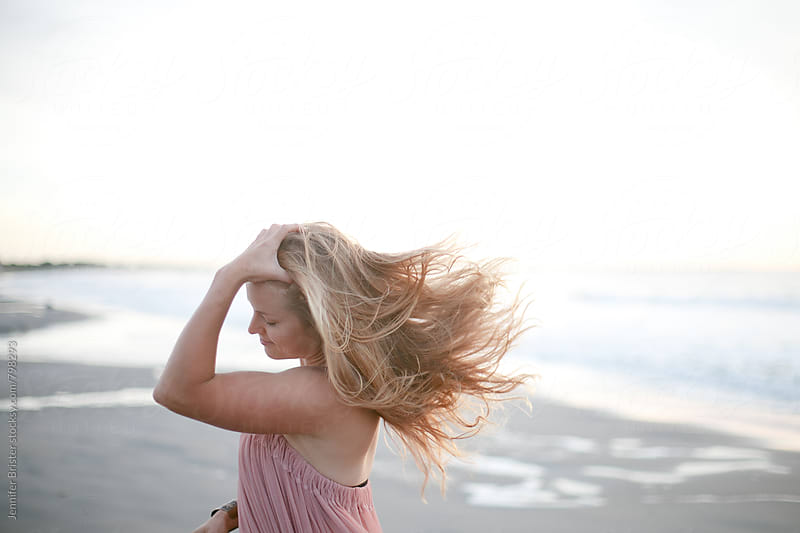 Woman with amazing beach hair by Jennifer Brister for Stocksy United
