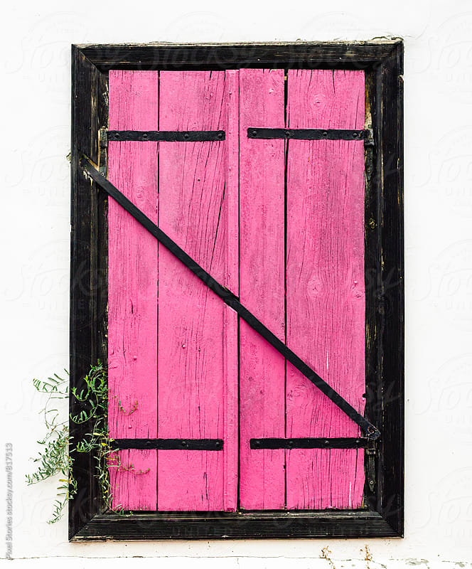 Pink exterior window shutters by Pixel Stories for Stocksy United