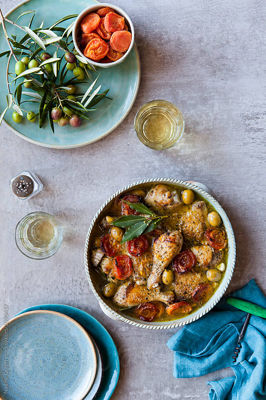 Moroccan chicken with sweet apricot and green olive sauce by Nadine Greeff for Stocksy United