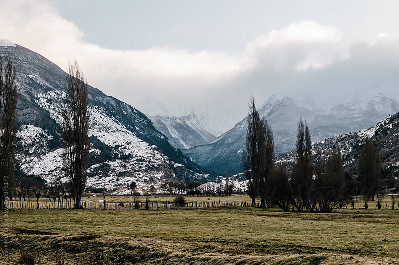 Rugged mountains and pasture land in Patagonia Chile by Justin Mullet for Stocksy United