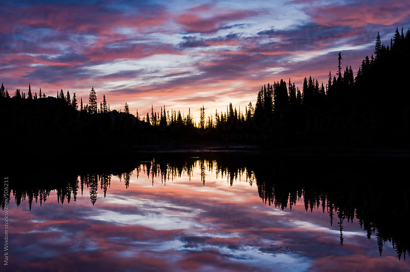 Colorful sunrise over Reflection Lake by Mark Windom for Stocksy United