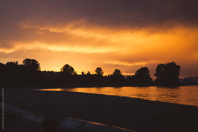 The storm clouds at sunset by Cherish Bryck for Stocksy United