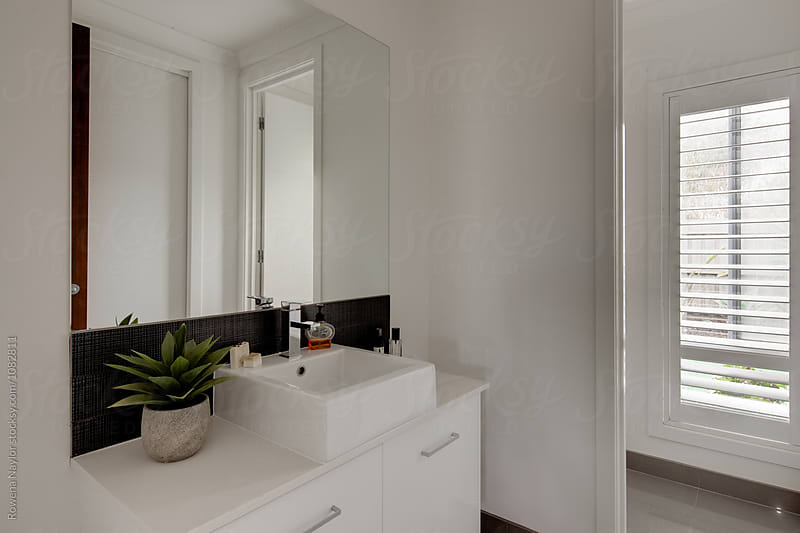 Samll bathroom by Rowena Naylor for Stocksy United