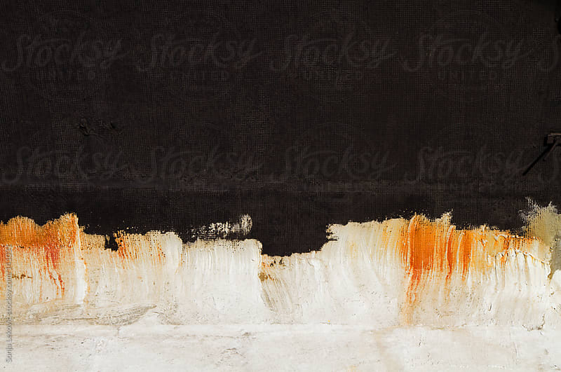 black painted wall balckground by Sonja Lekovic for Stocksy United