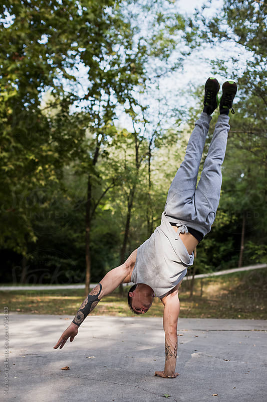 Man doing strong workout at the park. Handstand. by Mauro Grigollo for Stocksy United
