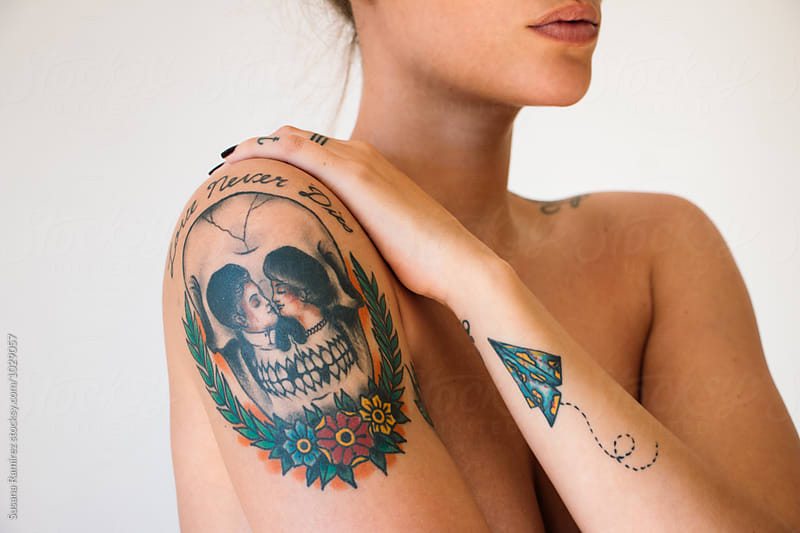 Portrait detail of woman with tattoos by Susana Ramírez for Stocksy United