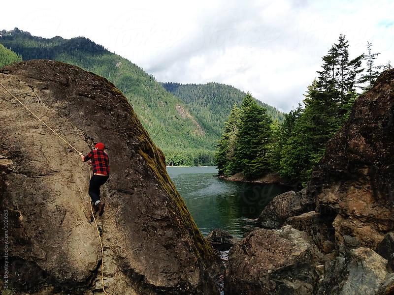 Man Freeclimbing Rock At Lake Cushman by Eric Bowley for Stocksy United