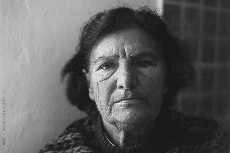 Portrait of senior woman in black and white by Dimitrije Tanaskovic for Stocksy United