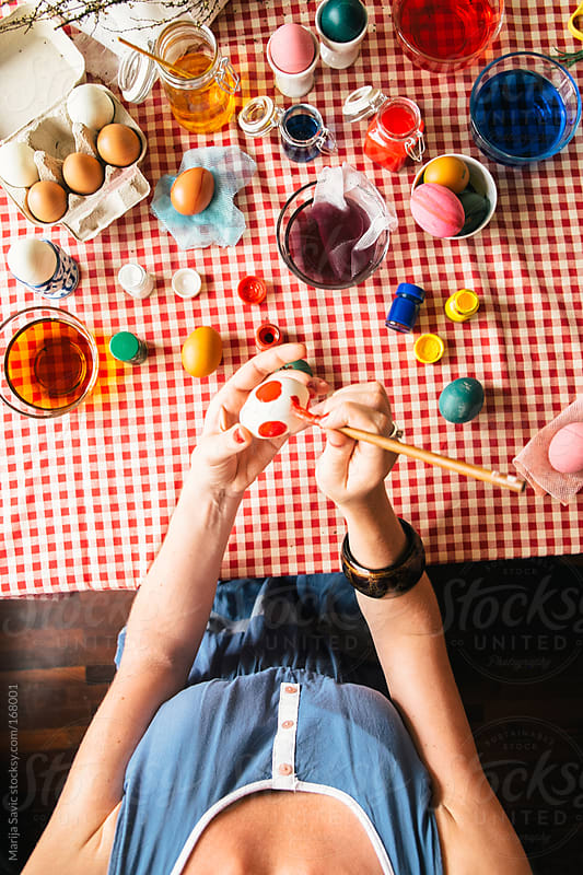 Woman Painting Easter Eggs by Marija Savic for Stocksy United