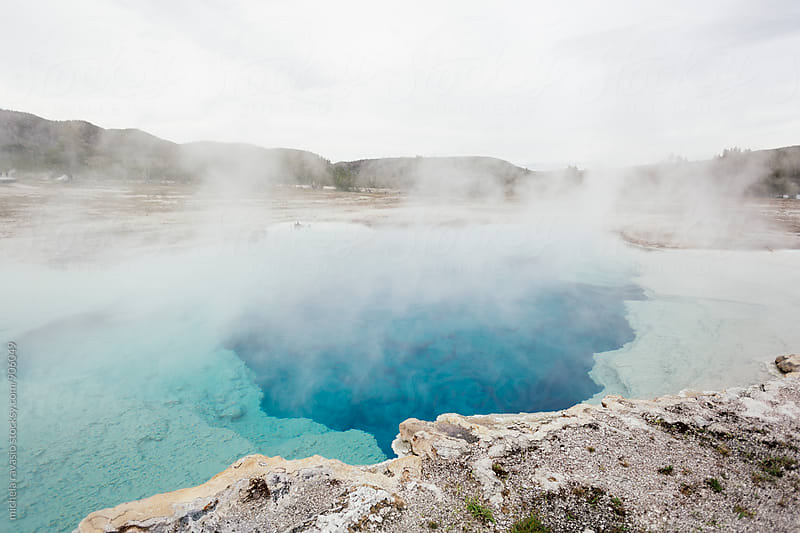 Blue hot pool in Yellowstone National Park by michela ravasio for Stocksy United