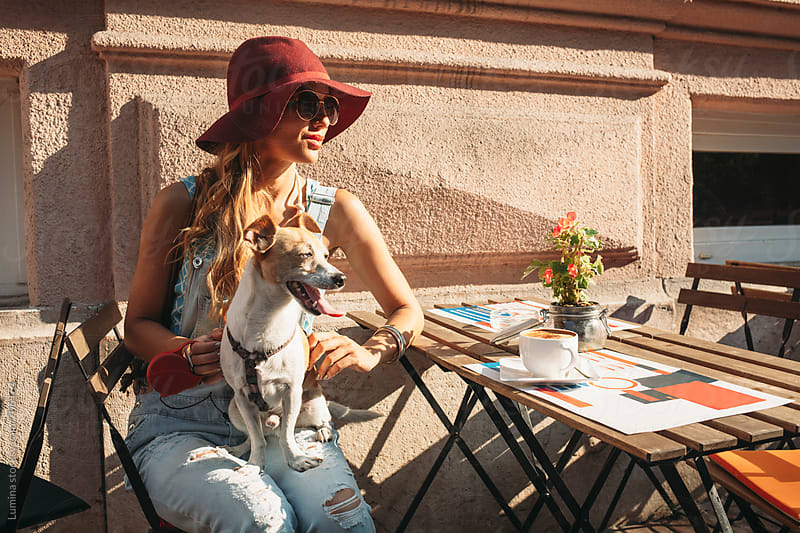Woman With a Dog in a Cafe by Lumina for Stocksy United