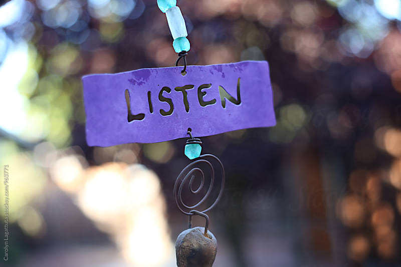Decorative metal sign with the word Listen by Carolyn Lagattuta for Stocksy United