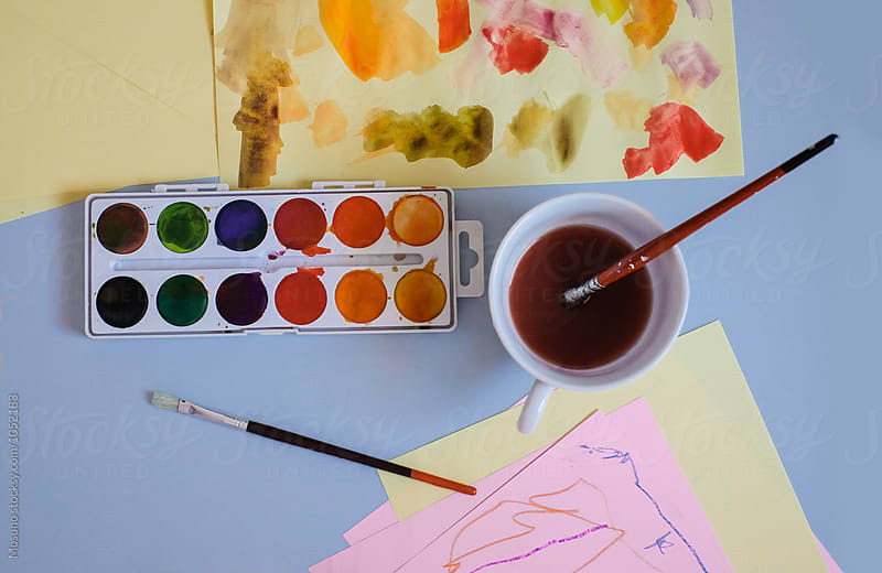 Watercolours and Child's Artwork on the Table by Mosuno for Stocksy United