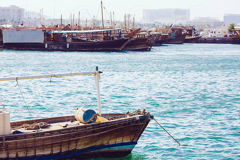 Old vintage wooden boats in Doha by Maja Topcagic for Stocksy United