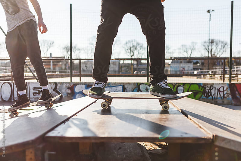 Two Young Skateboarders on a Ramp at the Skatepark by Giorgio Magini for Stocksy United