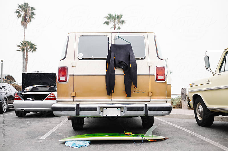 Wetsuit and Surfboard on Van by We Are SISU for Stocksy United