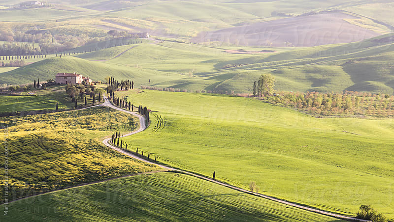 Tuscan houses at sunrise by Marilar Irastorza for Stocksy United