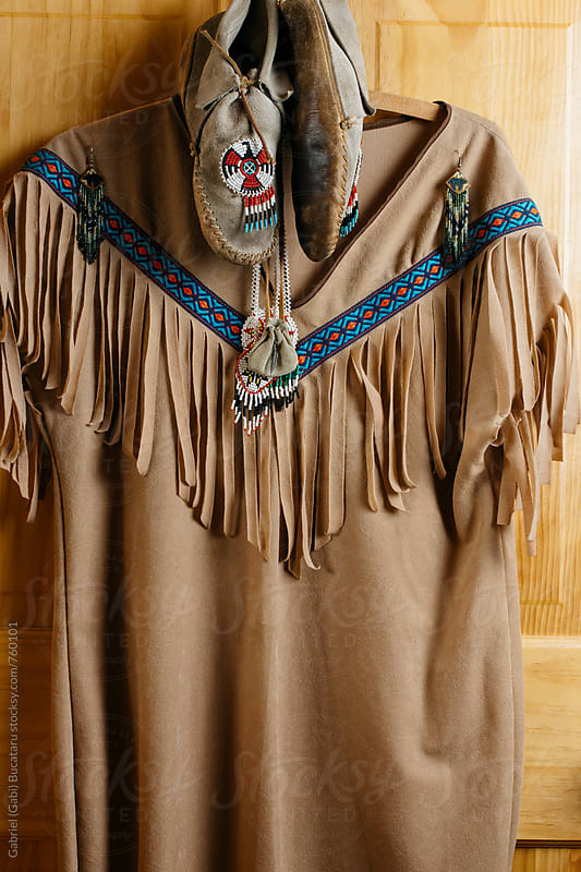 Native Indian tunic and moccasins by Gabriel (Gabi) Bucataru for Stocksy United