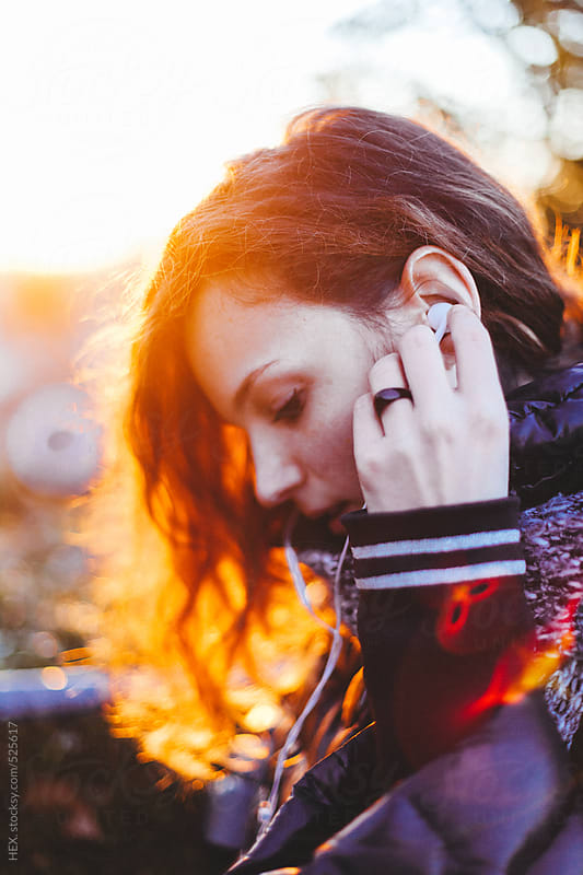 Pretty Young Female Student With Headphones During Sunset by HEX. for Stocksy United