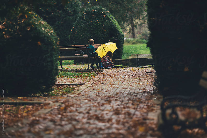 Children in autumn park by Dejan Ristovski for Stocksy United