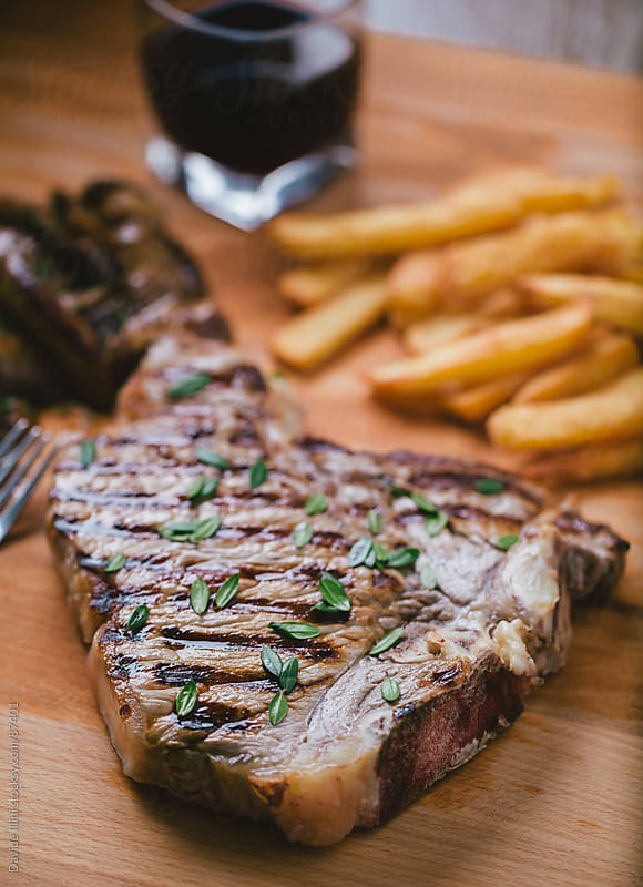 Grilled beefsteak with potateos by Davide Illini for Stocksy United