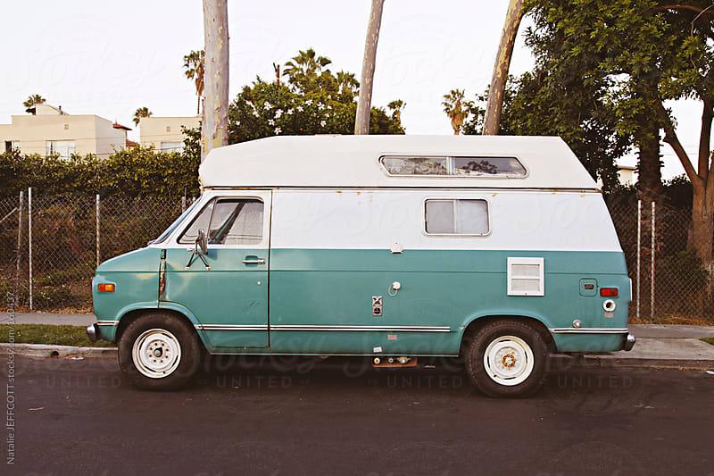 old car / van / truck park on a side street in Los Angeles by Natalie JEFFCOTT for Stocksy United