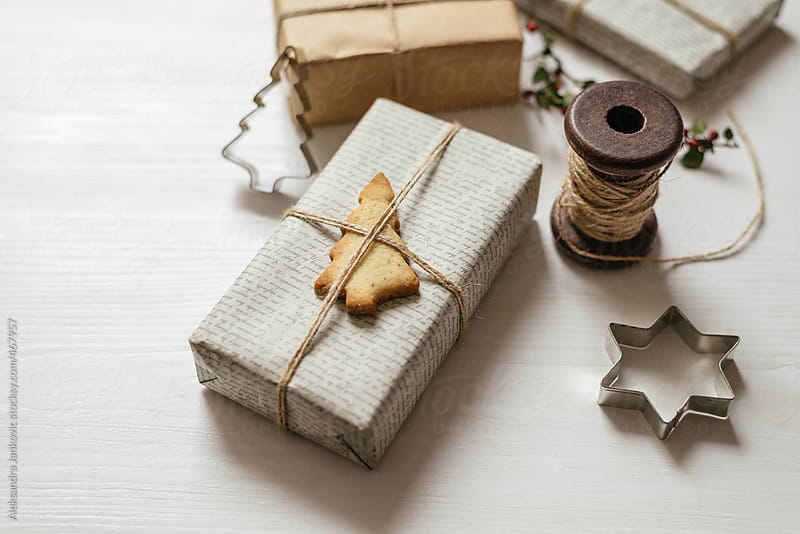 Close up of a Christmas presents with pine tree shaped cookie by Aleksandra Jankovic for Stocksy United