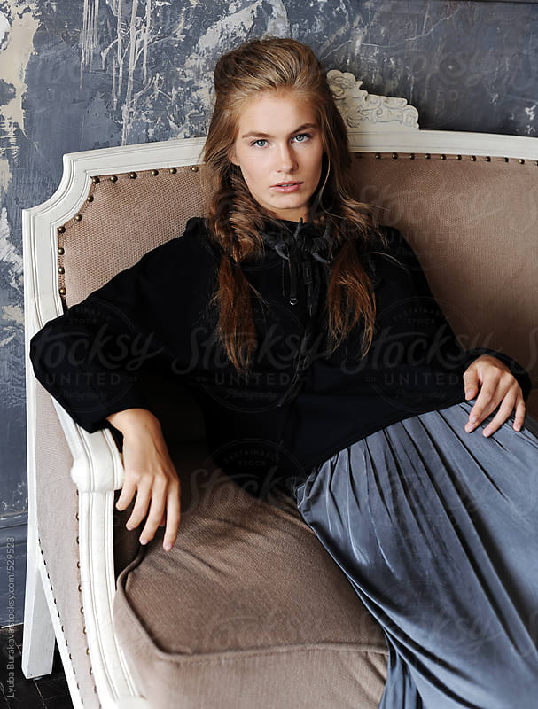Fashion portrait of young beautiful woman looking at camera by Lyuba Burakova for Stocksy United