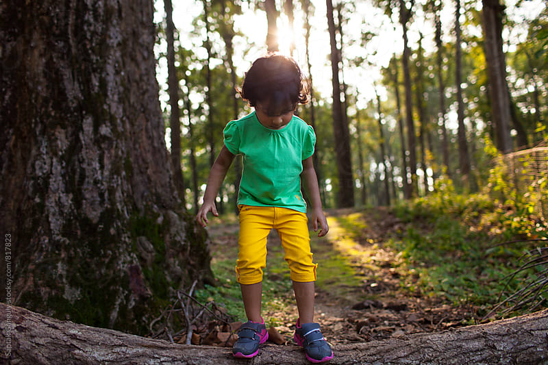 Little girl exploring in the forest by Saptak Ganguly for Stocksy United