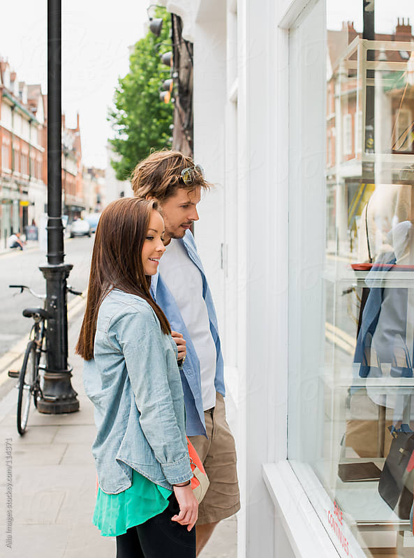 Couple Window Shopping by Aila Images for Stocksy United