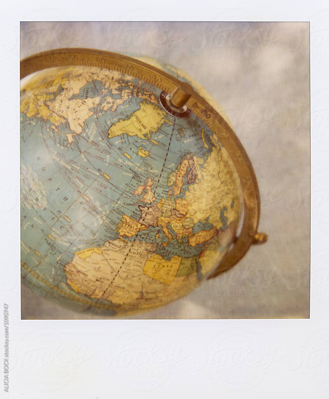 A Polaroid Photograph Of A Vintage Globe by ALICIA BOCK for Stocksy United