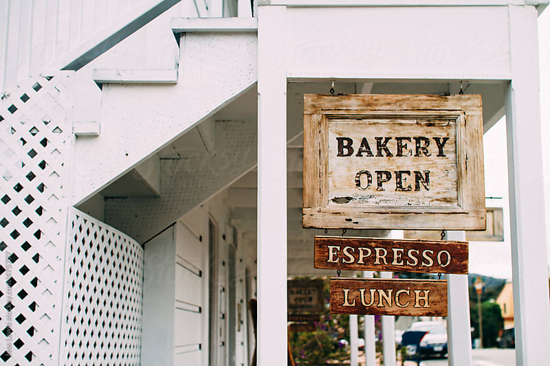open sign for cafe / bakery by Jess Lewis for Stocksy United