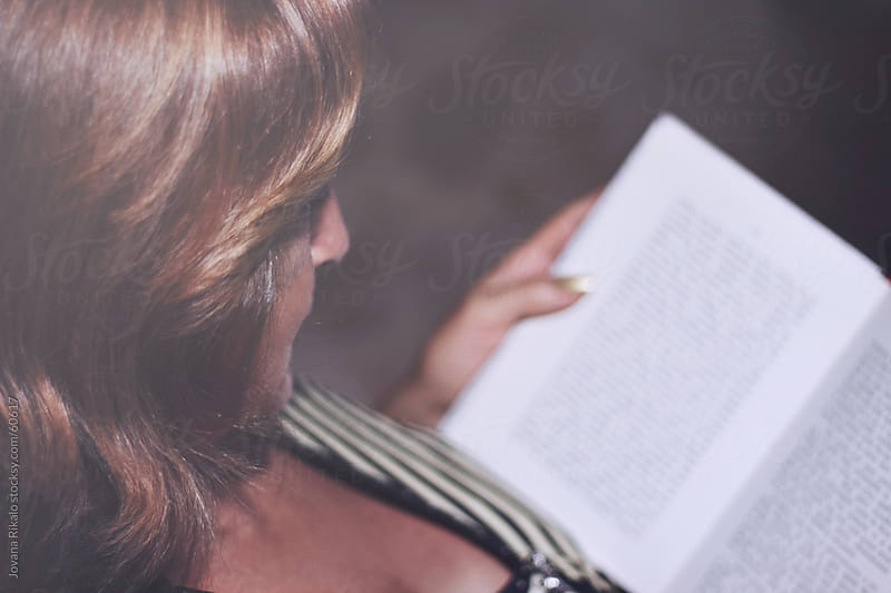 Mature woman reading a book by Jovana Rikalo for Stocksy United